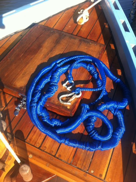 "The Anchor Buddy is a length of 3/8"" natural latex tubing sheathed in a hollow braided polypropylene line, and unlike an equivalent length of bungie cord, it will easily stretch from 14' to 50' and it won't get progressively harder to pull."