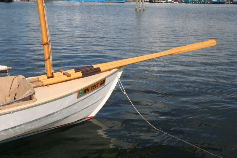 Two pairs of oars secured to the foredeck keep them out of the way while I'm sailing or at anchor.