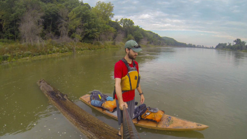 I had seen huge downed trees littered on the banks for almost 2000 miles but rarely saw one in the water. When I saw this one floating in the middle of the river just before Omaha I decided to stand-up paddle it until the next bend in the river.