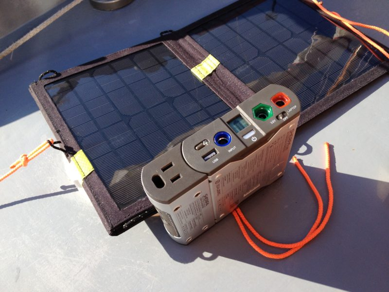 The power pack has an inverter attached (left with the AC outlet) . It is installed under the foredeck, out of the elements.