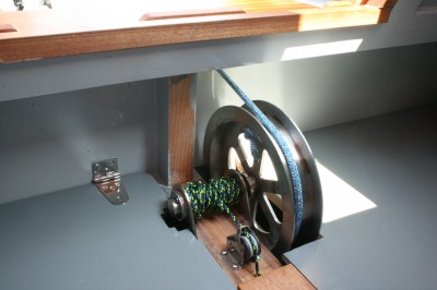 This pulley and axle provide a mechanical advantage for raising the lead-weighted centerboard.