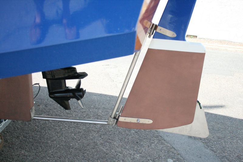 Stainless-steel tubing supports the rudder and protects the outboard.