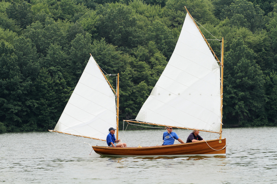 With 130 square feet of sail set, the Coquina slips along in light air.