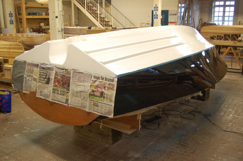 The bottom was reinforced with 15-oz biaxial cloth, and the entire hull was then sheathed in 6-oz cloth before being filled, faired, and painted.
