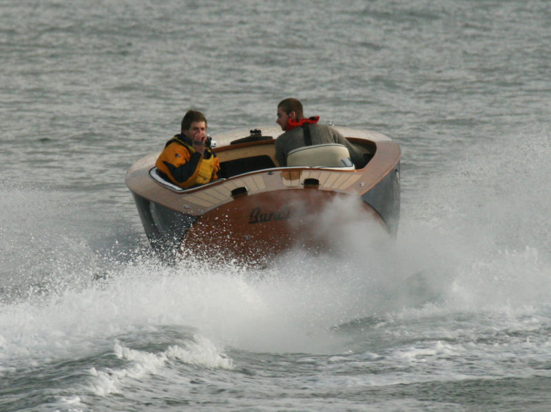 Brian Reford, a student at Lyme Regis Boatbuilding Academy, built BUNDUKI with an eye toward wake-boarding and water-skiing. He was particularly drawn to the design's pronounced tumblehome at the transom.