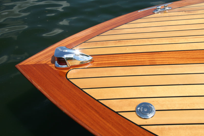 """The visible deck is an overlay applied to a ¼"""" subdeck. It consists of a khaya kingplank and covering boards, and spruce planks caulked with black polysulfide."""