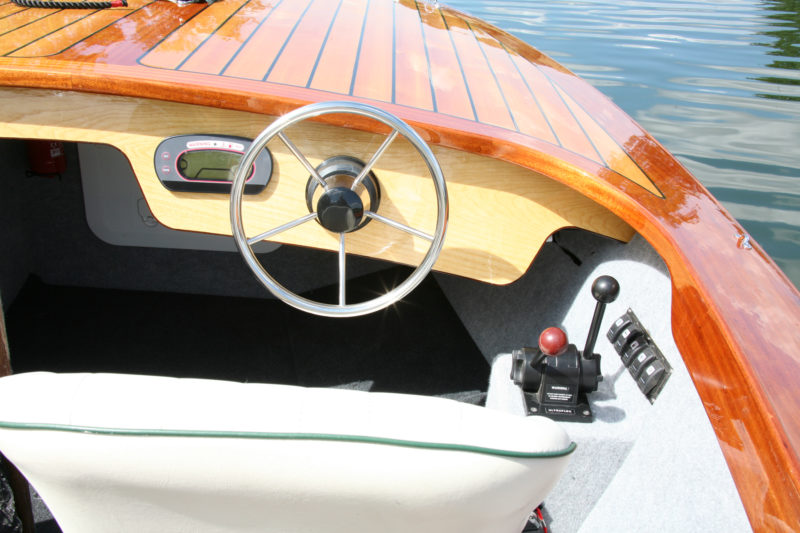 """The """"gear shift"""" lever of the controls operates a bucket that diverts the jet drive's water either forward or astern. The controls take some getting used to, for the shift's neutral position directs the water straight down, causing the boat to move slightly."""