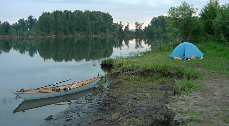 A bend in the river surrounded by farmland and forests provided me a place to camp. With little current and minor tides in the Mutlnomah Channel I could leave MAC overnight only slightly aground. A line from her bow to my wrist as I slept was all I needed to assure me that she'd not leave without me.