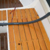 The inner tube has more than enough length to get water out of a boat with 6' beam. The hose is set up without twists to assure the unimpeded flow of the water.