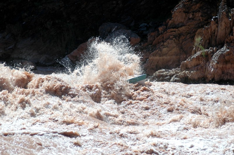 Randy Dersham, rowing the SUSIE TOO, hits his line perfectly between two explosion waves in Crystal Rapid. Before Glen Canyon Dam controlled river flows Crystal was a minor rapid but a major flash flood dramatically changed its difficulty and is considered by many to be the biggest rapid on the Colorado.