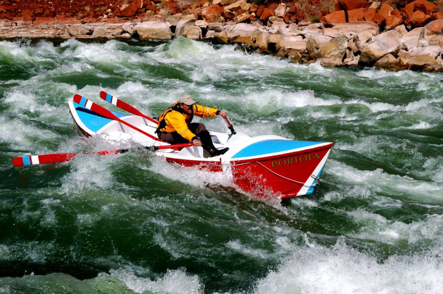 Greg Hatten races his PORTOLA down the tongue, hitting his line in Soap Rapid. Eleven miles below launch, this second major rapid has a 17' drop and gave the rowers a feel for the river and their newly built boats.
