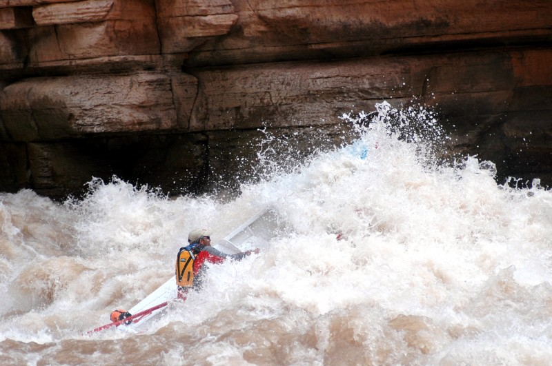 Upset Rapid at mile 150 has a 15' drop and a big spread in its it's rating: Class 3 to 8 depending on the water level. You have to stay perilously close to the canyon wall on this one in order to break through a big lateral wave at the bottom of the run.