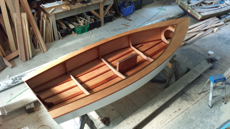 Mahogany stringers set under the plywood frames stiffen the bottom panels..