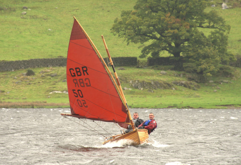 On Ullswater, a lake in NW England, Richard Fielden and Stephen Berrisford sail in Force-7 winds on the maiden voyage of dinghy GBR50. She's one of the few 12-Foot dinghies with reef points.