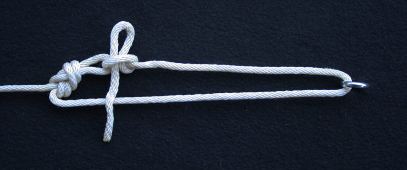A quick-release tension knot using a figure-8 on a bight and a slipped half hitch.