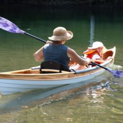Shair Rutz and her granddaughter take a maiden voyage on the Ompompanoosuc River near Norwich, Vermont.
