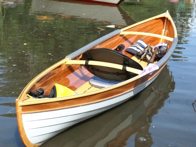 A bit of custom oiutfitting—footbraces and a padded backrest—give the canoe a kayak-like fit and feel. Foam pipe insulation