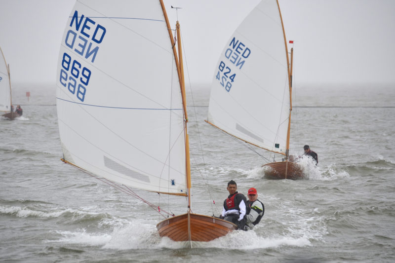 On the 100th anniversary of the first race of International 12 Foot Dinghies two Dutch crews race on England's River Dee near West Kirby in 2013.