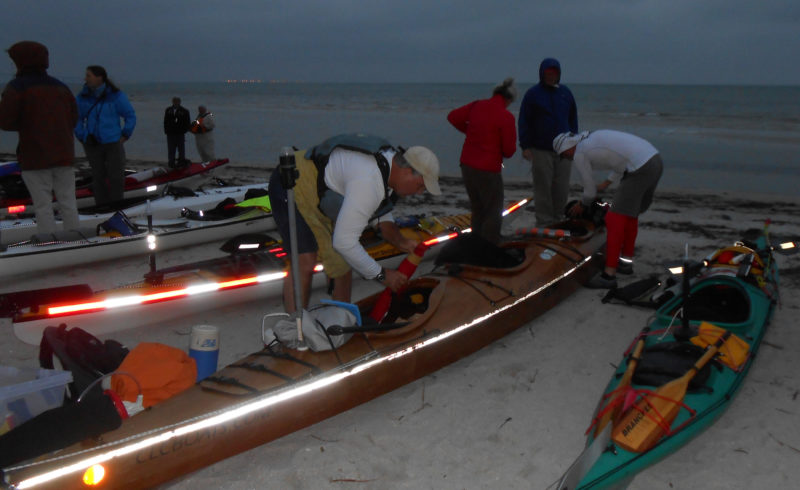 In the predawn light before the start at Fort Desoto Beach, Wally and Rod pack CONDOR with supplies and gear.