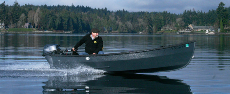 With the Candlefish's 20-hp outboard at full throttle, Sam Devlin skims smoothly long at over 20 knots.