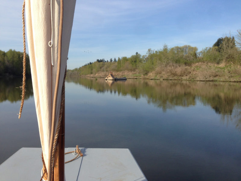 With water glassy and the rig brailed, I rowed up Lake River, passing an abandoned half-sunk vessel.
