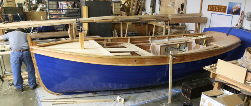 Discussion about the seat layout revolved around making the center thwart removable, or installing benches in place of it. Ultimately, the students decided to go with the designed fixed center thwart, even though there was no intention of rowing the boat. Vivier shows thole pins in the design, however.