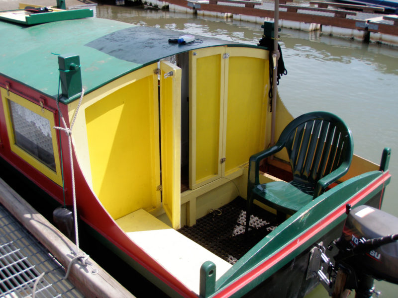The cockpit of SHAMBALA is built according to the plans. Builder Bryan Lowe omitted the hinged hatch over the companionway on the aft end of the cabin roof, but kept the one over the smaller passageway forward. Bryan steers SHAMBALA with his outboard. BONZO was ultimately outfitted and steered with the rudder drawn in the plans.