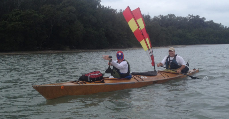 With the wind blowing out of the east, the sheetless two-meter sail provided little help. For Wally, still sporting his Los Humungos attire, and Rod lightweight canoe paddles are the best choice for the long haul in the kayak.