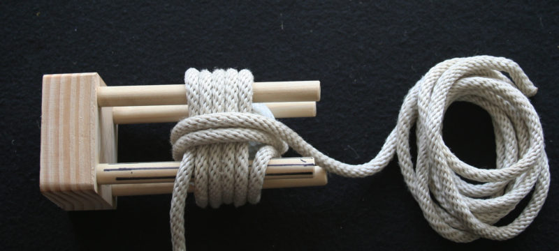 The second set of wraps is made around the first. Note that the second wrap starts by crossing the gap between the first wraps. This is less obvious when tying without the jig.