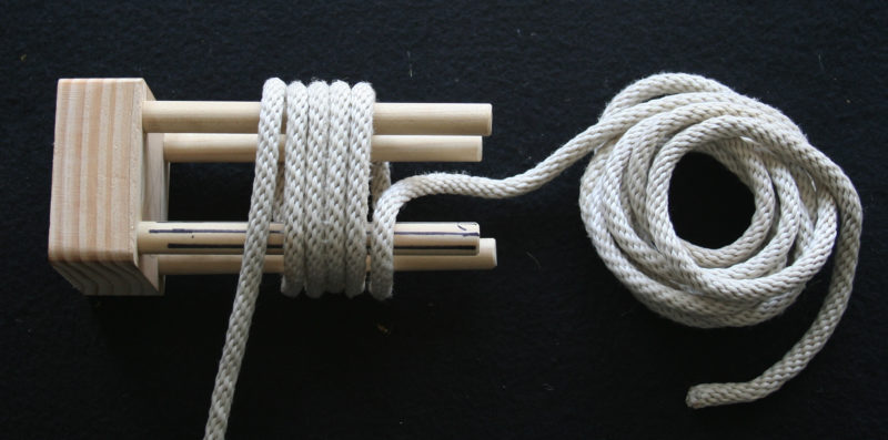 "The ¼"" line covers the golf ball with wraps made up of five coils, here starting and ending at the striped dowel."