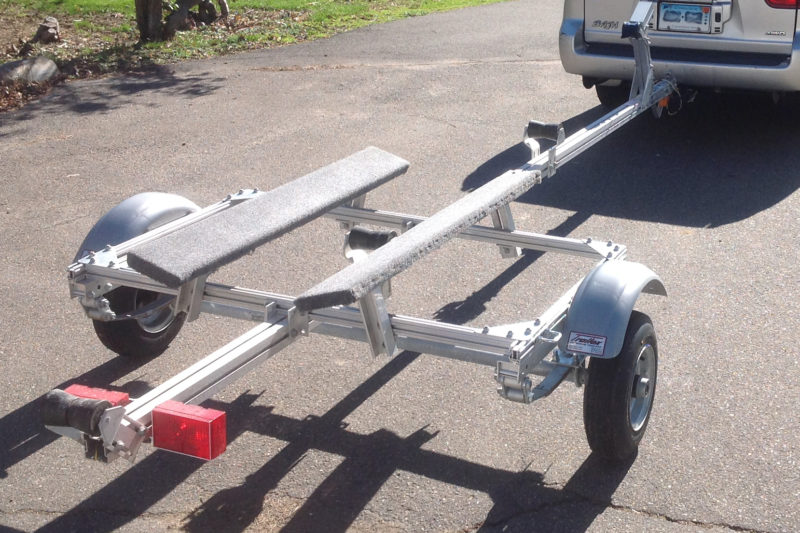 T-nuts slide in slotted aluminum box beams for a wide range of adjustments.