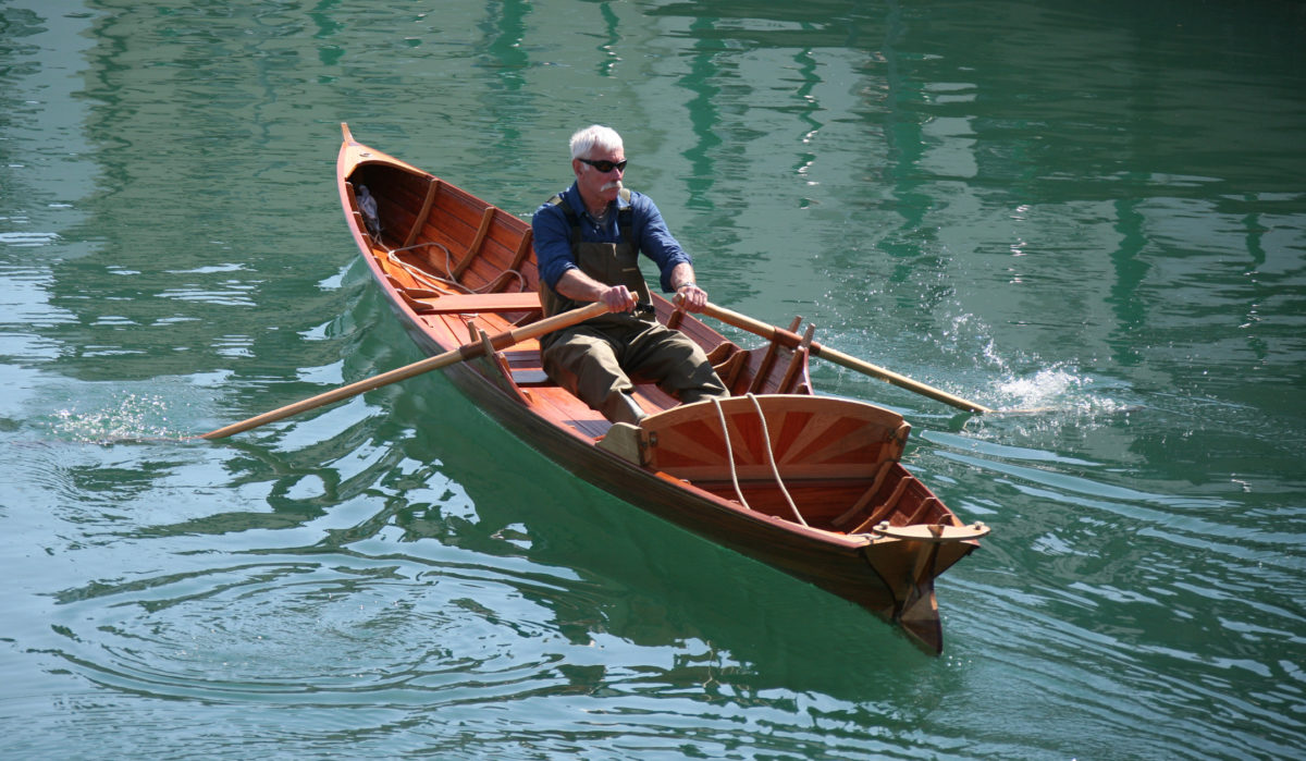 The Thames waterman's stroke, the traditional form of rowing a skiff of this type, is described in the Sept/Oct issue of WoodenBoat.