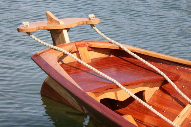 While seating provided in the stern, the passenger who'll be doing the steering sits well forward of the stern to maintain fore and aft trim.