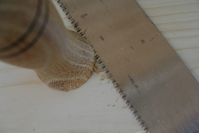 The hole for the handle is drilled at 10°. Careful repeated saw cuts get the flange of to sit flush against the back.