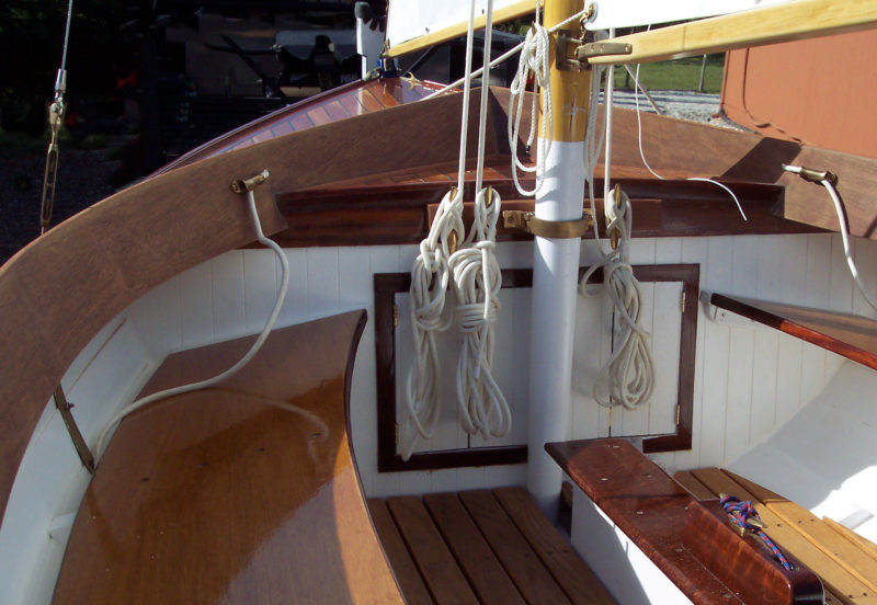 Canted benches and broad coaming offer secure and comfortable seating while under sail.