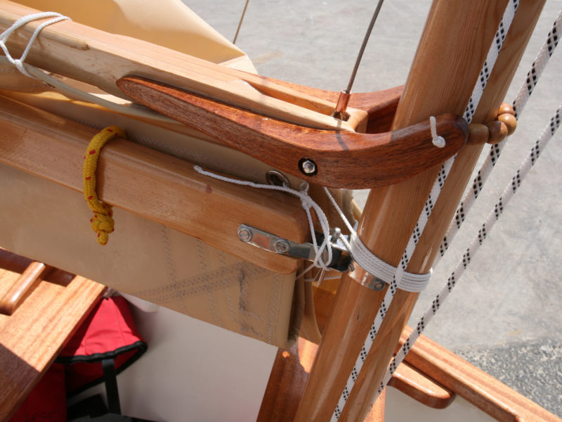The mahogany gaff jaws were laminated to give its curved shape strength. The boom gooseneck is an off-the-shelf fitting for a Mirror dinghy.