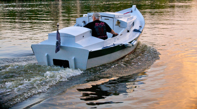 PILGRIM's 15-hp 4-stroke outboard is housed in a compartment that keeps its noise from interfering with conversations in the cockpit.