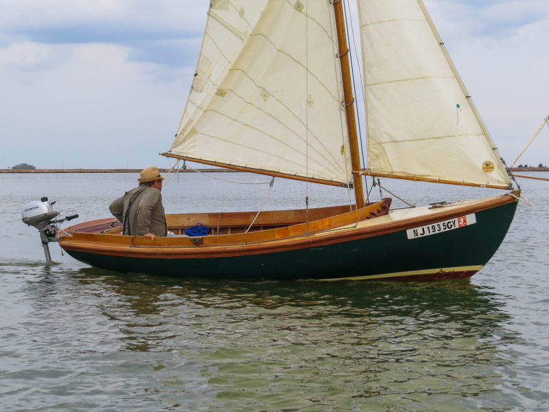 The Haven 12 ½, JACKAROO, gets a boost from the outboard during a lull in the wind.