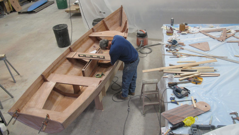 The hull is quite stiff after being glued and glassed; once it is off of the jig it will keep its shape without spalls to hold the beam.