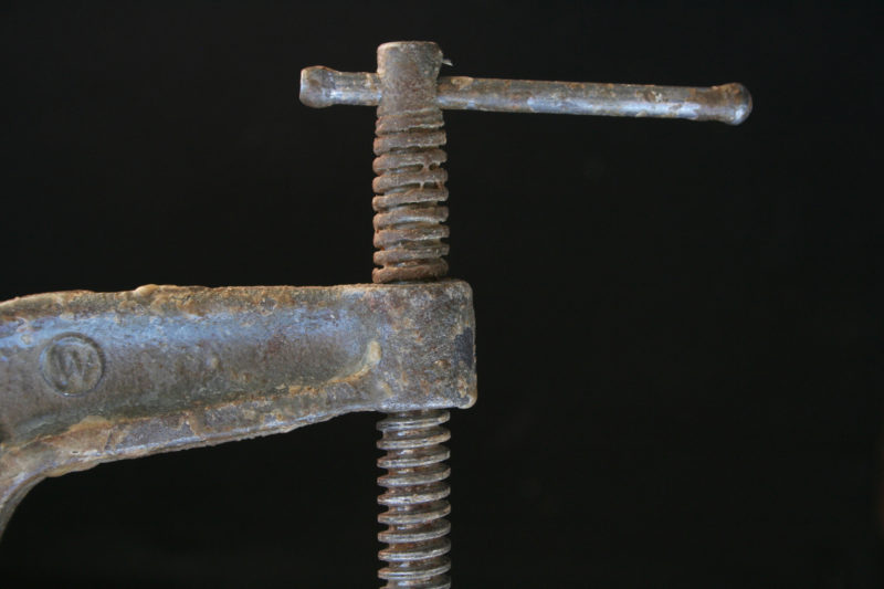 Before cleaning, this clamp had lost its full range and its smooth action.