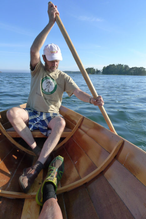 A paddler seated aft can contribute power and a high degree of maneuverability. The traditional paddle is long and has a grip like that of an oar.