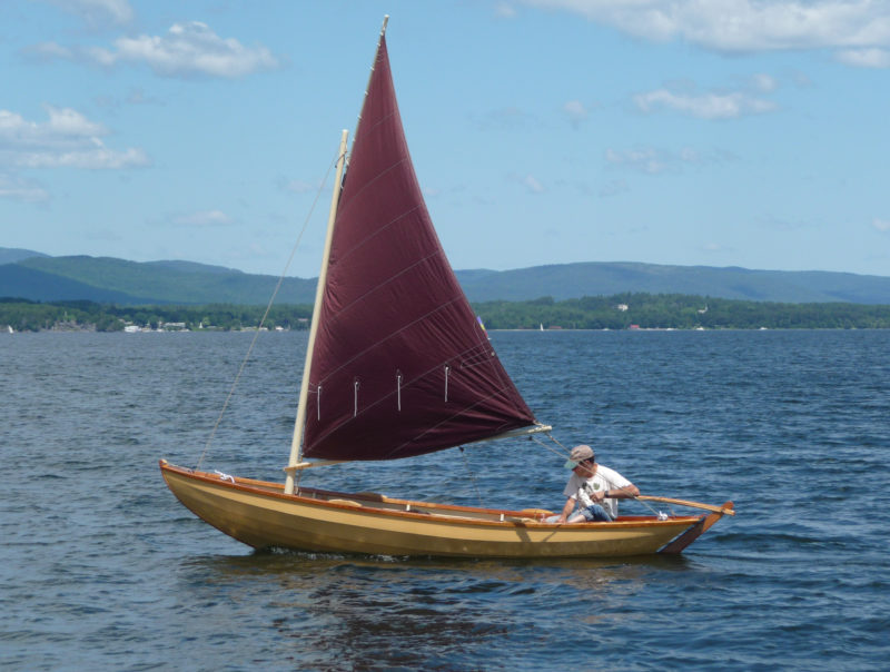 """John Gardner wrote: """"These Swampscott boats are the aristocrats of the dory clan. Here is a Swampscott dory that is not too large for one man, or even a strong boy, to handle, yet large enough to retain all of the excellent qualities for which the type is noted."""" While Gardner's plans called for a sprit rig, I substituted this standing lug rig so that in an emergency while sailing alone I could drop the sail quickly while still at the tiller. The spars are all of solid red spruce (Picea rubens) and the tanbark sail is Dacron."""