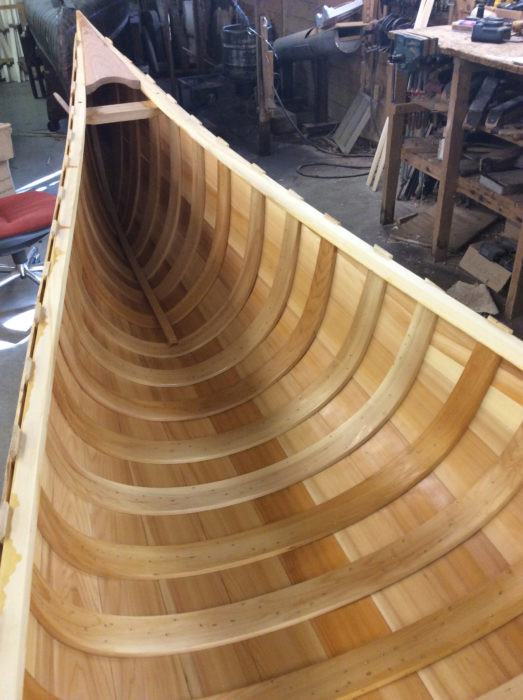 The first base coat of thinned varnish provided good preview of what the finished canoe was going to look like.