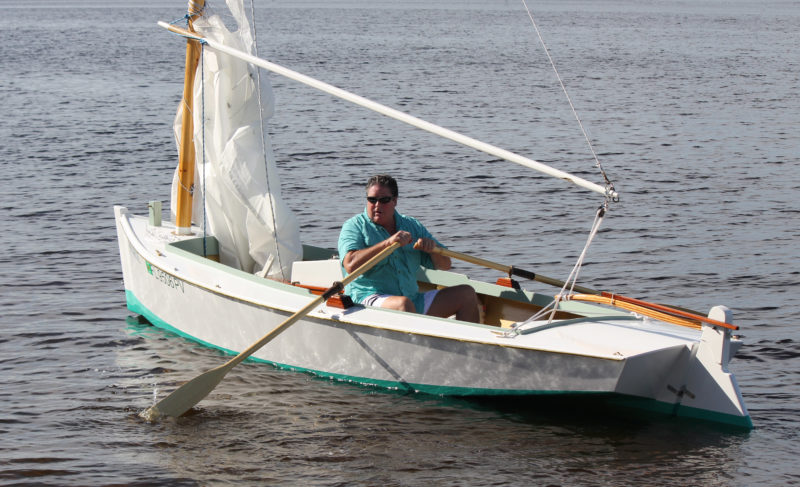 Kevin takes to the oars on his way out to sail the waters around Cape Coral, Florida