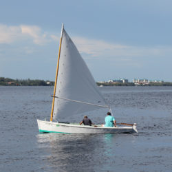 The sail SAOIRSE carries is easily furled and the rig dropped to allow passage under a low bridge on the way home.