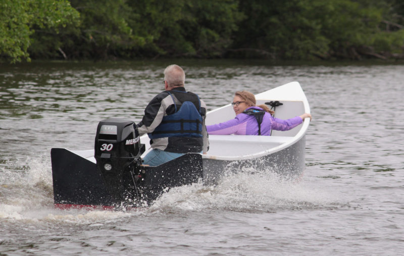 Jon and his daughter Keri take off. The transom, drawn in the plans with a straight upper edge and meant for a long-shaft motor, has a recess to accommodate a short shaft outboard.