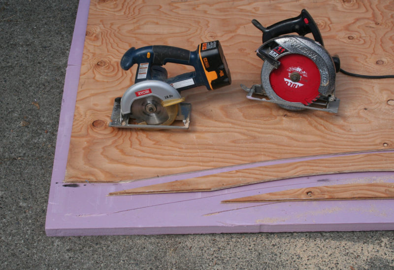 """Sawing sheets of plywood is quick and safe when it's resting on a sheet of rigid foam insulation (1 1/2"""" shown here)."""