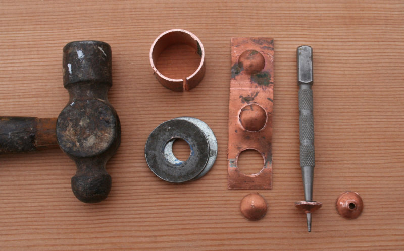 With a ball-peen hammer, a piece of copper water pipe, a couple of washers and a nail set you can make your own dished roves.