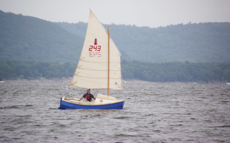 The SCAMPS's 100-sq-ft sail is set high for good visibility under the boom and is easily reefed.