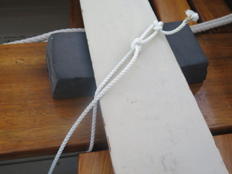 The oars are lashed at both looms and blades to keep them and the foam pads in place.
